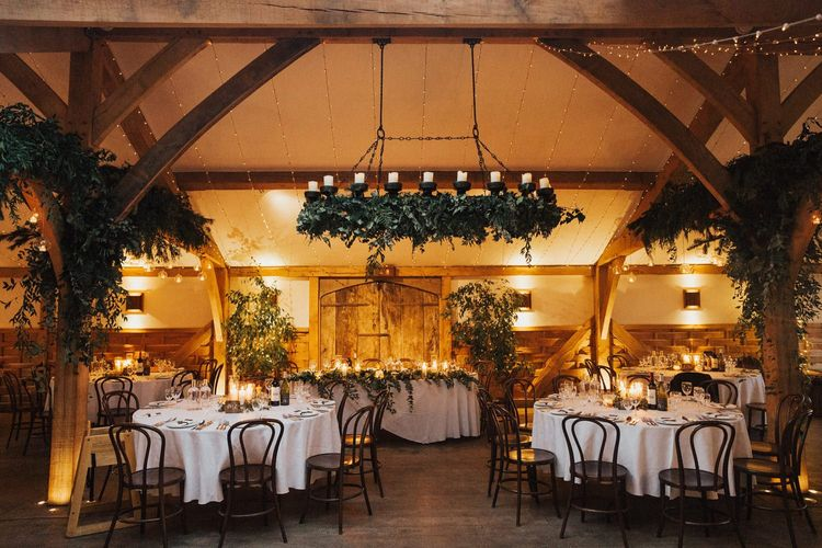 Cripps barn wedding reception with foliage and candles
