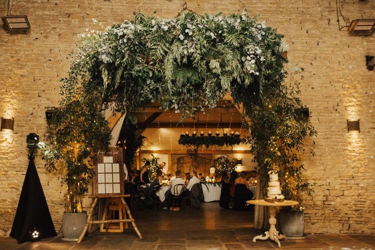 Foliage arrangement for entrance to barn reception