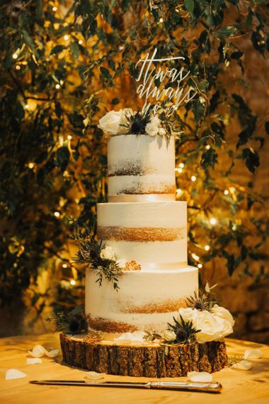 Semi naked wedding cake on tree stump cake stand