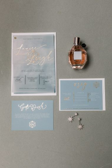 Blue wedding stationery suit with gold lettering