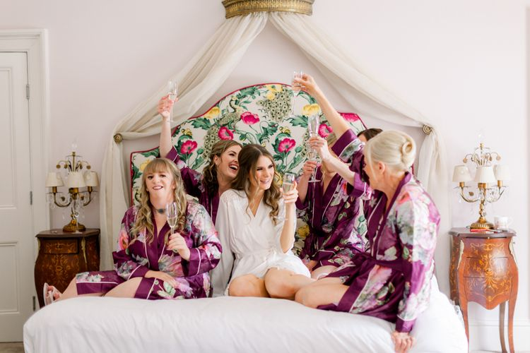 Bridal party on wedding morning at Garthmyl Hall in getting ready robes
