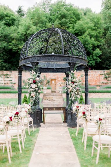 Arbour at Garthmyl Hall decorated in flowers