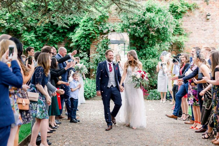 Bride and groom confetti moment at Garthmyl Hall
