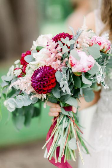 Bridal bouquet with deep pink dahlia, pink peonies and eucalyptus