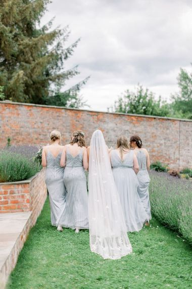 Bridesmaids in blue sequin dresses from Monsoon