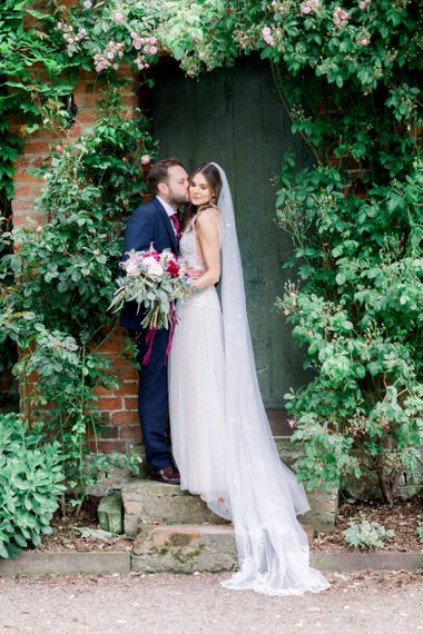 Bride and groom portrait in the gardens at Garthmyl Hall by Jo Bradbury Photography