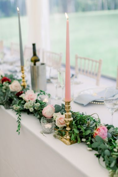 Top table wedding flowers and coloured candles