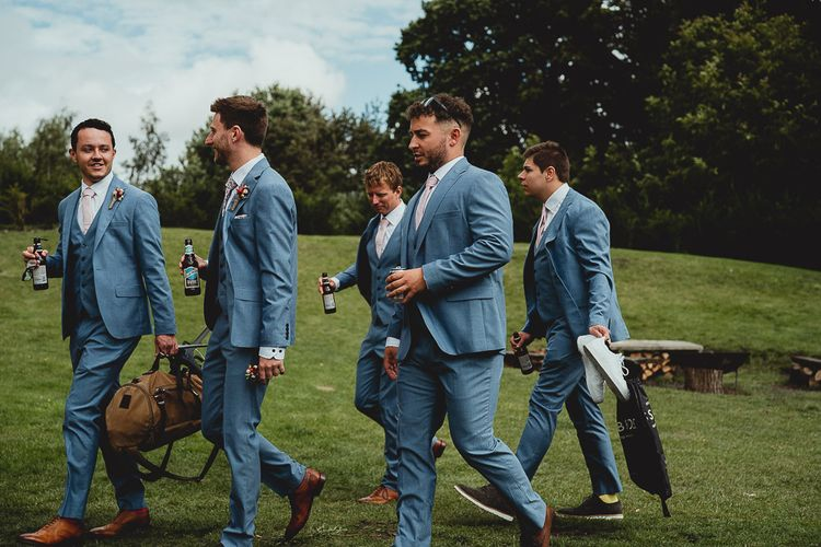Groom and groomsmen making their way to the outdoor ceremony