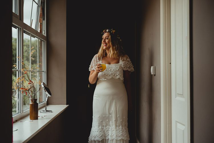 Bridal preparations for celebration with DIY wedding bunting and flowers