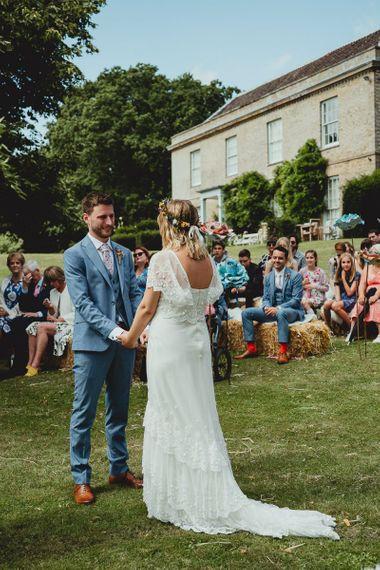 Bride and groom during garden ceremony in Norfolk