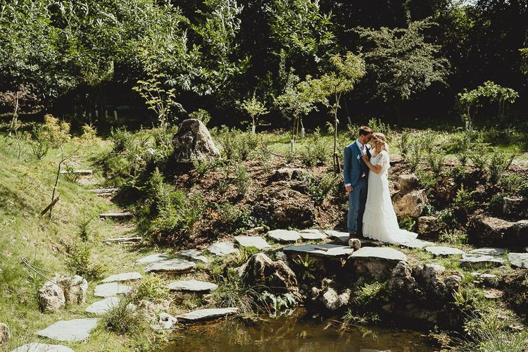 Bride and groom take a moment in the Norfolk wedding venue grounds