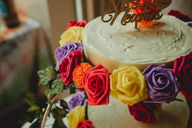 Wedding cheese cake with cake topper and flower decoration