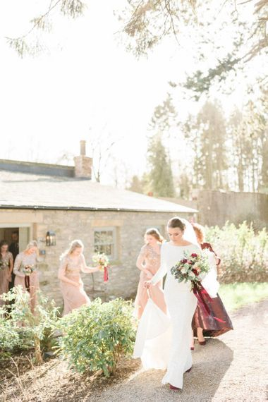 Bride in Justin Alexander wedding dress walking to her February wedding ceremony