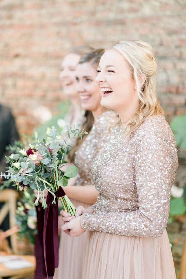 Bridesmaid in blush sequin dress laughing