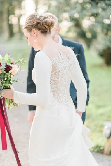 Sheer lace back detail on fitted wedding dress