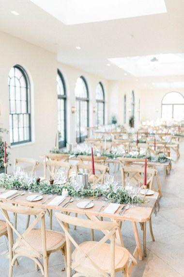 The Fig House, Middleton Lodge wedding reception with deep red taper candles and foliage
