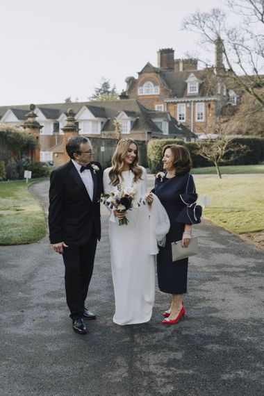 Father and Mother of the Bride with Their Daughter