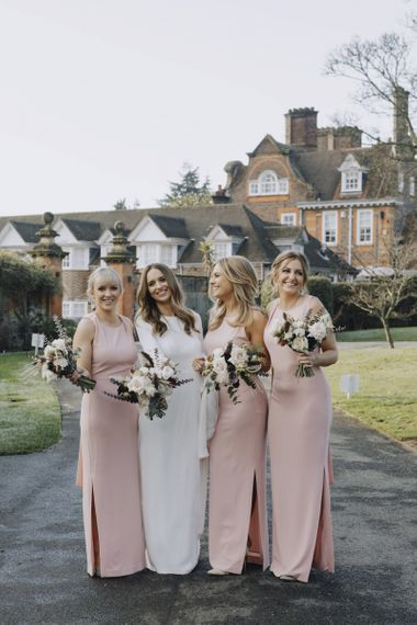 Bridal Party Portrait with Bridesmaids in Pink Whistles Dresses and Bride in Emma Beaumont Wedding Dress