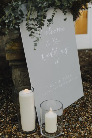 Grey Wedding Welcome Sign with White Calligraphy Writing and Candle Decor