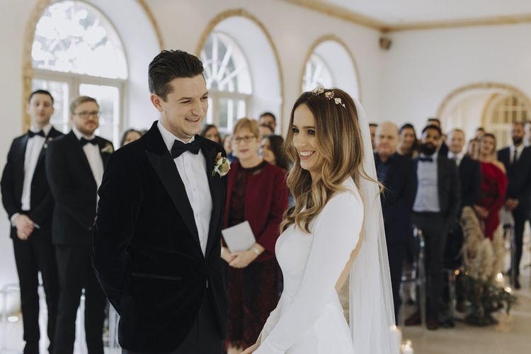 Wedding Ceremony with Bride and Groom Exchanging Vows