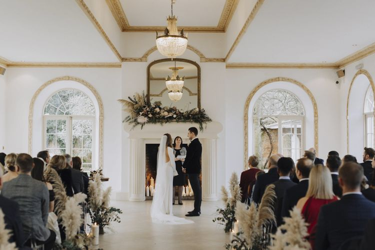 Wedding Ceremony at north brook Park with Pampas Grass Aisle Flowers