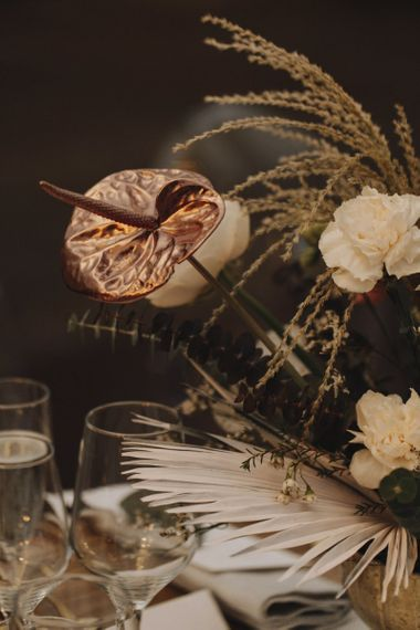 Dried Palm Leaf, Spray Painted Lily and Muted Flower Arrangement