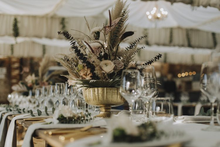 Wedding Flower Arrangement in Gold Vessel with Pampas Grass, Feathers, Muted Roses and Foliage