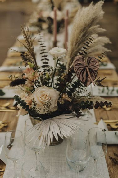 Wedding Flower Centrepiece in Gold Vessel with Pampas Grass, Feathers, Muted Roses and Foliage