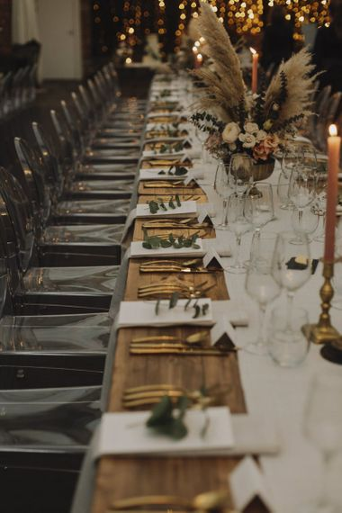 Place Settings with Gold Cutlery and Ghost Chairs