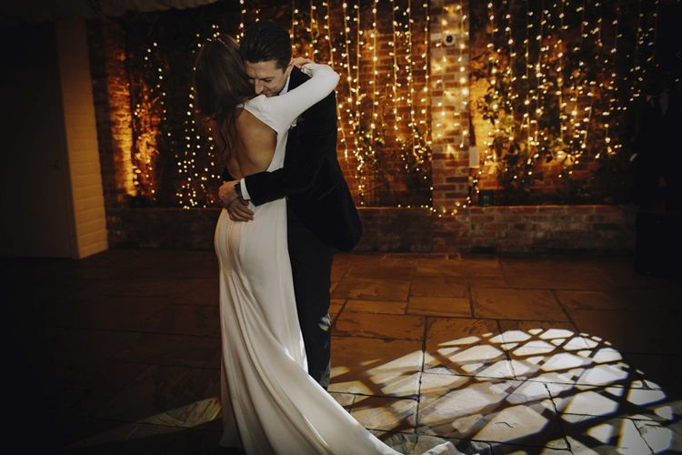 First Dance with Bride in Backless Emma Beaumont Wedding Dress and Groom in Tuxedo