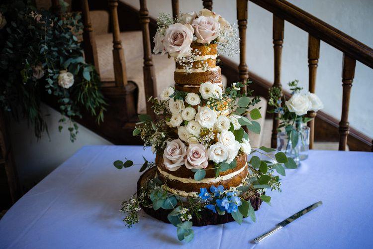 Naked Wedding Cake with Wild Flower Wedding Decor