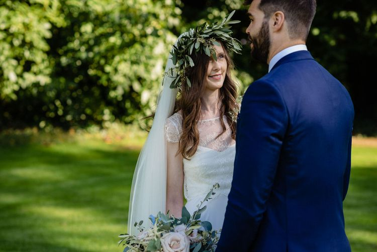 Bride in Charlie Brear Wedding Dress and Olive Flower Crown with Groom in Ted Baker Navy Suit