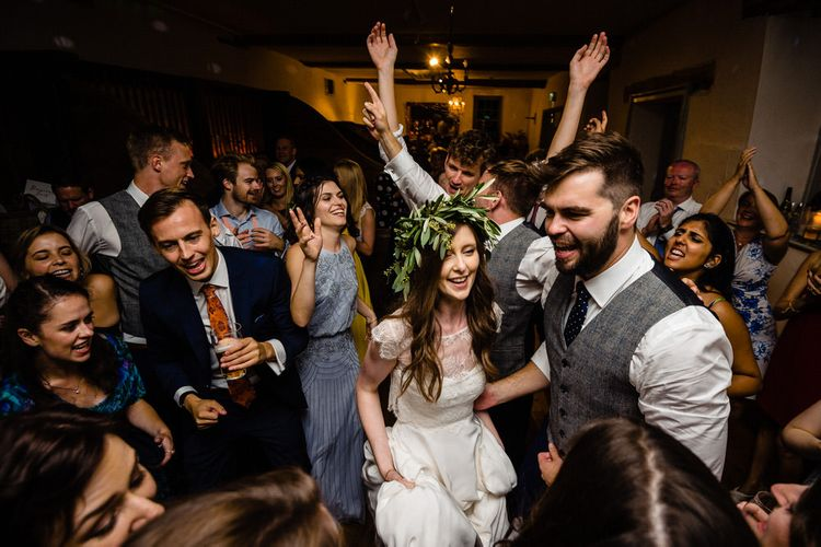 Evening Reception with Bride in Charlie Brear Wedding Dress and Olive Flower Crown with Groom in Ted Baker Navy Suit