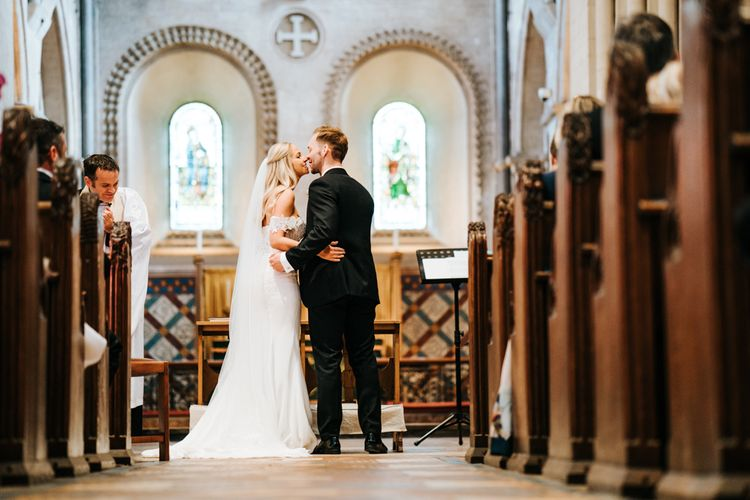 Bride and Groom at the Church Altar