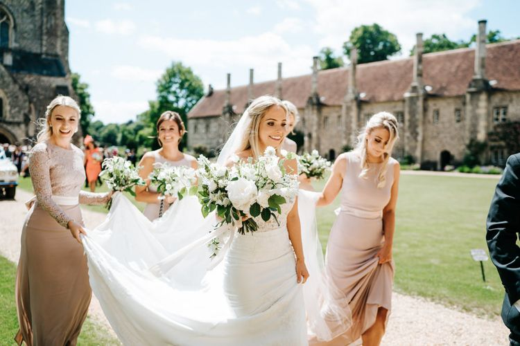 Bride and Bridesmaids in the Church Courtyard