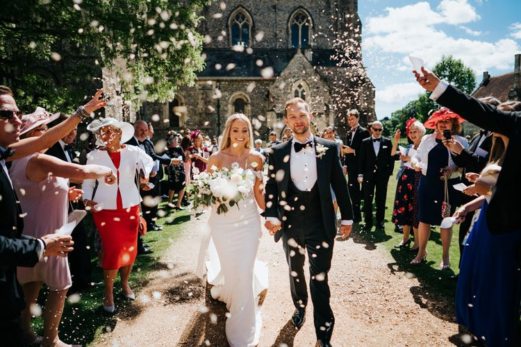Bride and Groom Church Courtyard Confetti Moment
