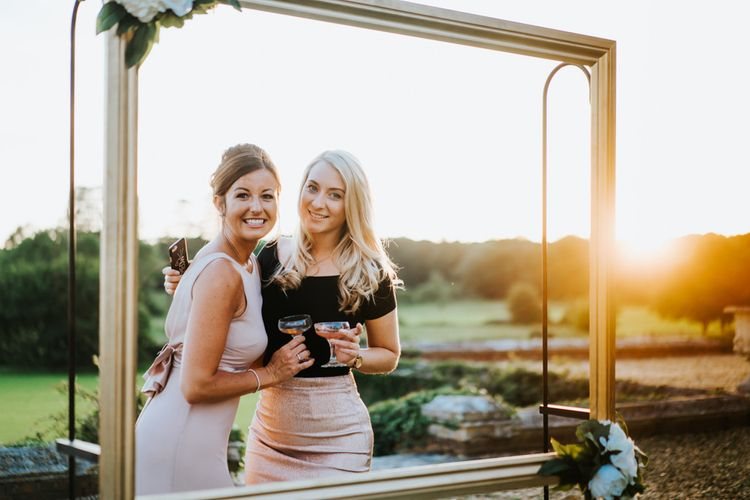 Wedding Guests Posing in Gold Frame