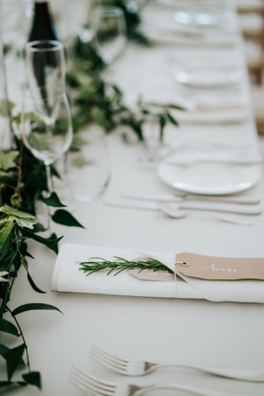 Elegant Place Setting with Luggage Tag and Rosemary Sprig