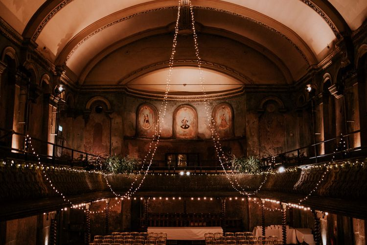 Mezzanine at Wilton's Music Hall with Hanging Fairy Lights Decor