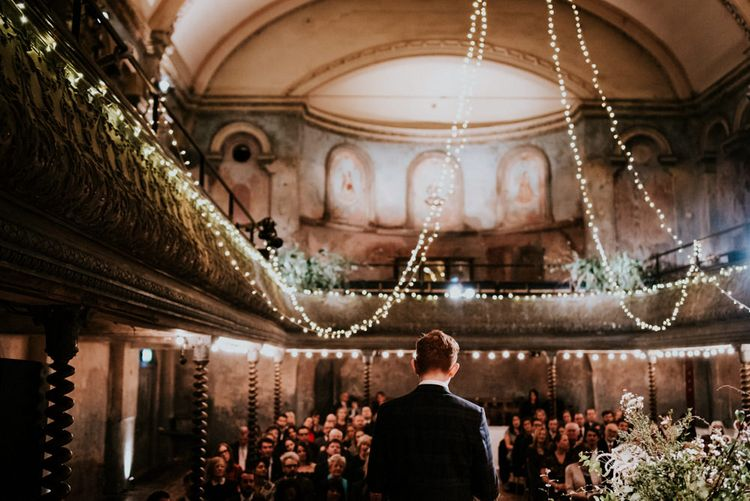 Wedding Ceremony with Groom Waiting on Stage at Wilton's Music Hall for His Bride to Arrive