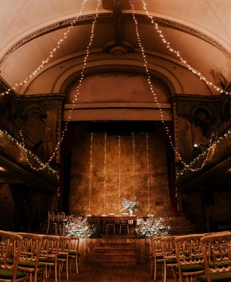 Wedding Ceremony at Wilton's Music Hall with Hanging Fairy Lights