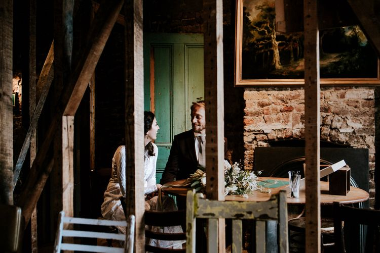 Portrait of Bride in Grace Loves Lace Wedding Dress and Groom in Dark Suit  at Wilton's Music Hall