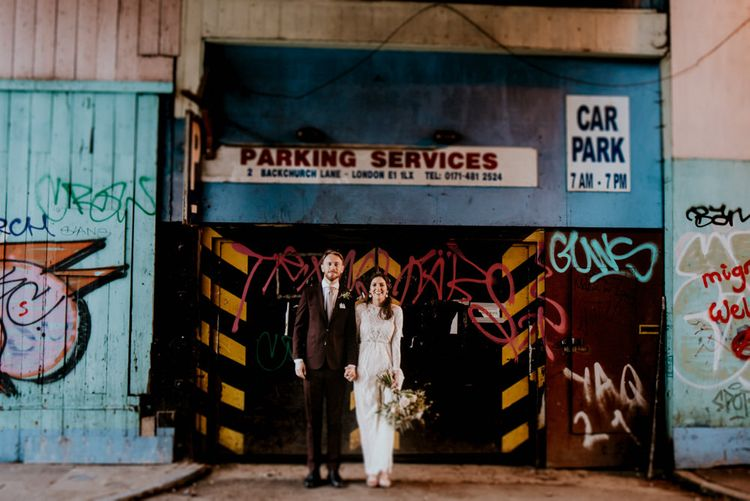 Portrait of Bride in Grace Loves Lace Wedding Dress and Groom in Dark Suit  in Urban London
