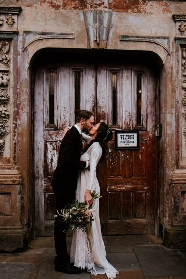 Urban Portrait of Bride in Grace Loves Lace Wedding Dress and Groom in Dark Suit Outside Wilton's Music Hall