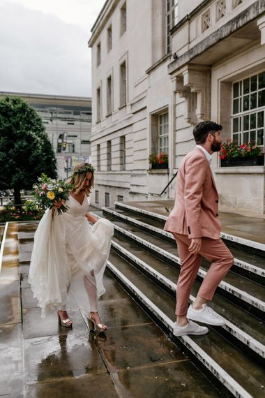 Bride and groom walking up the steps to their Hackney Town Hall micro wedding