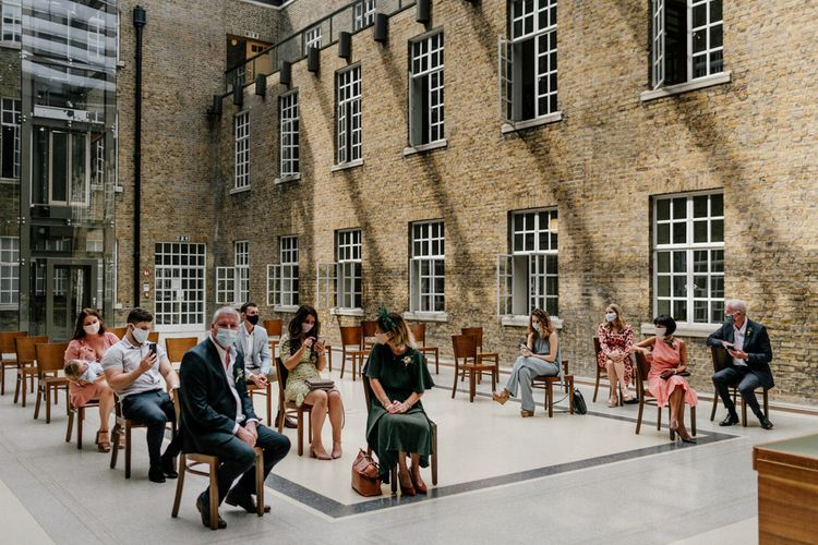 Intimate wedding ceremony at Hackney Town Hall under the roofed atria