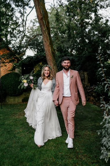 Boho bride in Catherine Deane wedding dress and groom in blush suit