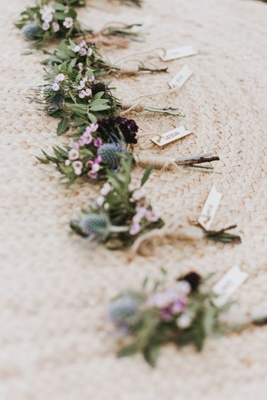 Wildflower buttonholes for groomsmen at sustainable wedding