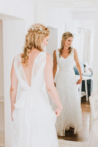 Bride wears second-hand wedding dress by Charlie Brear