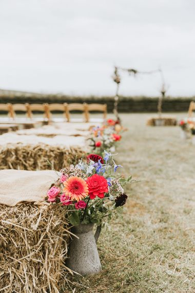Wildflowers line the aisle at vegan wedding